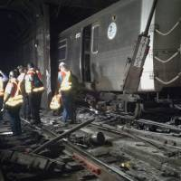 Minor subway derailment near Harlem leaves seven hurt, causes outage, delays
