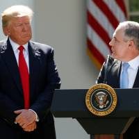 Does Trump believe in climate change or not? Aides won't say