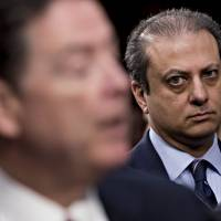 Preet Bharara, former U.S. attorney for the Southern District of New York, listens as former Federal Bureau of Investigation Director James Comey (left) speaks during a Senate Intelligence Committee hearing in Washington Thursday. | BLOOMBERG