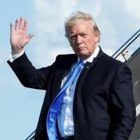 U.S. President Donald Trump arrives at Newark International airport in New Jersey on Friday to spend a weekend at Trump National Golf Club in Bedminister, New Jersey. | REUTERS