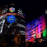 An exit poll predicting that the Conservative Party  will win 314 seats in the British general election is projected onto BBC Broadcasting House, Portland Place, in London, on Thursday after the polls closed.   AFP-JIJI