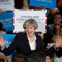 Britain's May still in talks with hard-line party on deal to back Conservative government