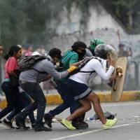Teen protester dies, bringing toll to at least 66 as violence again engulfs Venezuelan capital