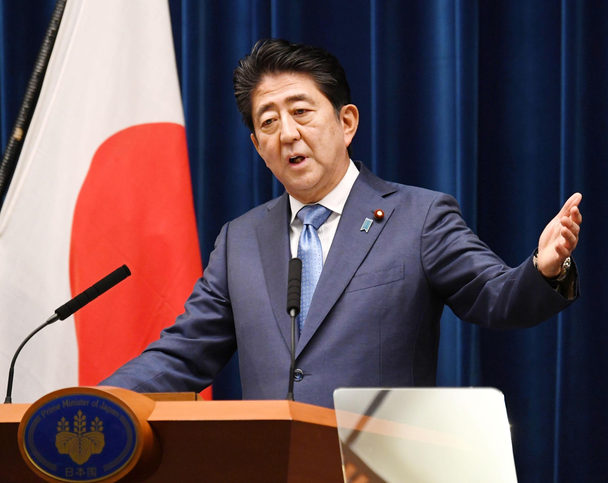 Prime Minister Shinzo Abe holds a news conference Monday evening at the Prime Minister's Office in Tokyo to mark the end of the ordinary Diet session on Sunday. | KYODO