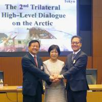 Kazuko Shiraishi, Japan's ambassador in charge of Arctic affairs, is flanked by her South Korean and Chinese counterparts, Kim Young-jun (right) and Gao Feng, at the Foreign Ministry Thursday. | KYODO