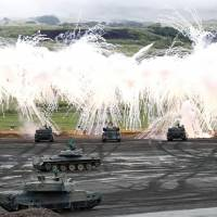 Ground Self-Defense Force tanks take part in an annual live-fire drill at the foot of Mount Fuji last August.   KYODO