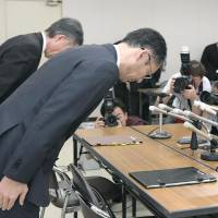 Officials of the Fukuoka Prefectural Government apologize at a news conference Thursday at the headquarters of the prefectural police after a sergeant in the force was arrested over the slaying of his family, . | KYODO