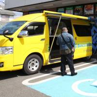Roving vans serve Japanese-Brazilian community's banking, food and other needs