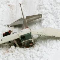 A crashed Cessna is seen on a mountain in Tateyama, Toyama Prefecture, on Saturday. The four people on board were found dead.   KYODO