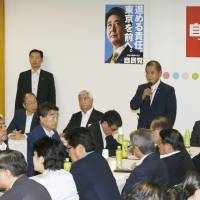 Okiharu Yasuoka, who chairs the Liberal Democratic Party's panel tasked with promoting revisions to the Constitution, speaks during the group's meeting Wednesday at party headquarters.   KYODO
