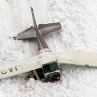 The wreckage of a Cessna 172P that crashed during a training flight Saturday in Toyama Prefecture is shown early Sunday. All four aboard were killed. | KYODO