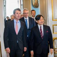 Crown Prince Naruhito and Crown Prince Frederik of Denmark visit the opening of 'Japan in the Royal Family,' an exhibition marking the 150th anniversary of diplomatic ties between Japan and Denmark, in Copenhagen on Friday. | REUTERS