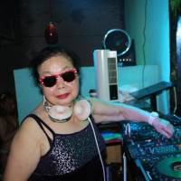 Sumiko Iwamuro, 82, spins her beats as DJ Sumirock at a club in Tokyo's Kabukicho district Saturday. The octogenarian is proof that age doesn't matter and says there is much more waiting in life ahead. | KYODO