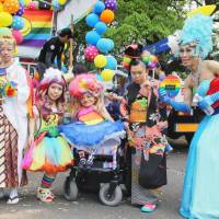 Hitomi Goto (second from left) takes part in an event supporting lesbian, gay, bisexual and transgender people in Tokyo on May 7. Despite a genetic condition that stunts physical growth, Goto has successfully pursued her dreams in the fashion industry.   KYODO