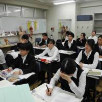 Around 20 students listen to a lecture at Nihon Human Ceremony College, the only institution in Japan that trains embalmers, in Hiratsuka, Kanagawa Prefecture, earlier this month.   KYODO