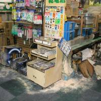 An electronics store in the city of Sakai, Osaka Prefecture, is seen after a man who was on fire rushed in Monday. KYODO