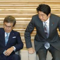 Prime Minister Shinzo Abe attends a Cabinet meeting to approve the government's latest road map to fiscal health on Friday evening. | KYODO