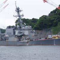 The damaged USS Fitzgerald is seen at the U.S. naval base in Yokosuka, Kanagawa Prefecture, on Sunday ahead of a news conference by the U.S. Navy. | REIJI YOSHIDA