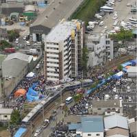 The train that derailed, killing 107 people and injuring another 562 on the JR Fukuchiyama Line in Amagasaki, Hyogo Prefecture, is seen in this April 2005 photo. | KYODO