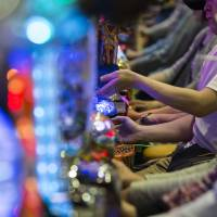 Customers at a pachinko parlor in Tokyo on May 16. | BLOOMBERG