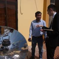 A Panasonic Corp. employee works as a consultant for a Vietnamese solar-cooker maker in Da Nang, Vietnam, in February 2012. He was the first to be dispatched under nonprofit group Cross Fields' corporate volunteering program. | COURTESY OF CROSS FIELDS