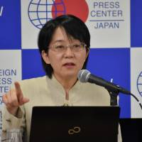 Masayo Takahashi, a researcher at the Riken institute's Center for Developmental Biology, speaks during a news conference at the Foreign Press Center in Tokyo on June 7.   SATOKO KAWASAKI