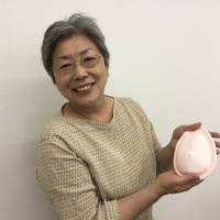 Mieko Ichinomiya displays a hand-sewn pad for breast cancer survivors on Thursday in Sapporo. She developed the pad as she was recovering from cancer herself. | SUMIKO OSHIMA