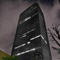 The building that houses travel agency H.I.S. Co. is shown in this photo taken in Shujuku Ward, Tokyo, in January. Labor authorities referred H.I.S. to prosecutors for allegedly making employees work an illegal amount of overtime. | KYODO