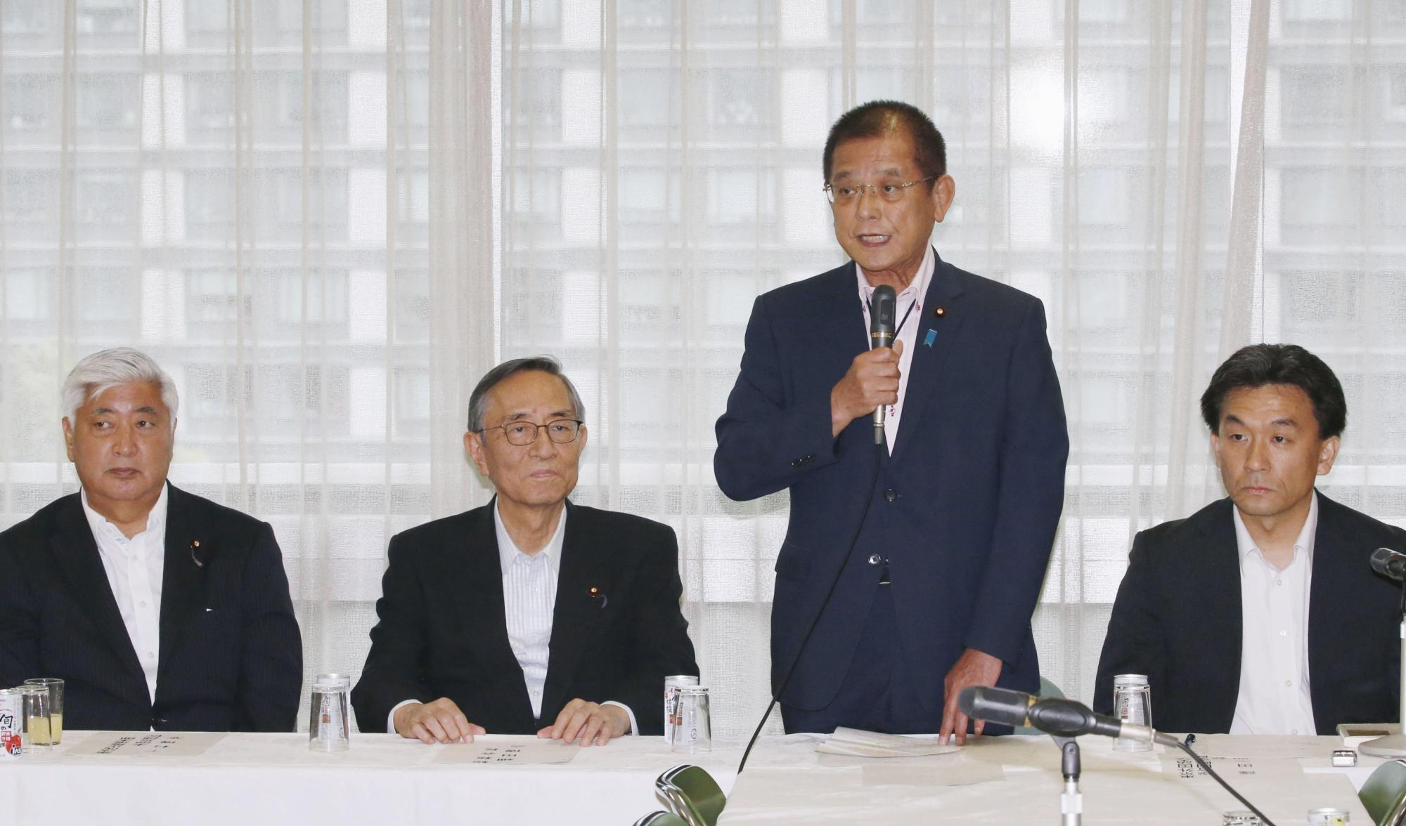 Okiharu Yasuoka, head of the ruling Liberal Democratic Party's constitutional reform panel, speaks during a meeting Monday at LDP headquarters in Tokyo.   KYODO