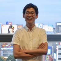 Shigeyoshi Suzuki, an elementary school teacher and an openly gay man, says Japan lags behind in gender equality education. The photo was taken on May 25 in Tokyo's Shibuya Ward. | MAGDALENA OSUMI