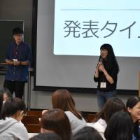 Kanako Sando (right) of ReBit, a Tokyo-based nonprofit LGBT support group ReBit, speaks during a lecture on sexuality at St. Margaret's Junior College on Wednesday in Tokyo's Suginami Ward. | SATOKO KAWASAKI