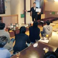 Single men listen to matchmaking adviser Sosuke Takahashi in Ojiya, Niigata Prefecture, after participating in a konkatsu spouse-hunting event in March. | KYODO