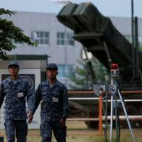 Japan's defense budget, which has stayed at around 1 percent of gross domestic product for decades, should be increased to deal with ongoing security challenges, a ruling Liberal Democratic Party panel said Tuesday. | REUTERS