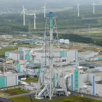 A reprocessing plant for spent nuclear fuel is seen in the village of Rokkasho, Aomori Prefecture. Japan plans to seek a nuclear pact with the United States that will renew automatically, sources said Tuesday. | KYODO