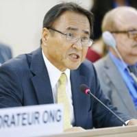 Hiroji Yamashiro criticizes the Japanese government for allegedly oppressing anti-base protesters in Okinawa, during a speech Thursday to the U.N. Human Rights Council in Geneva. | KYODO