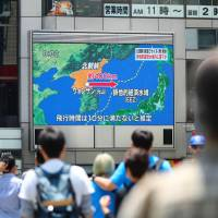 A big screen TV in the city of Osaka shows the news of North Korea's missile launch May 29. | KYODO
