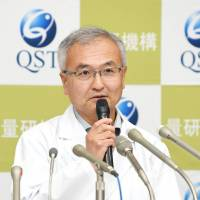 Makoto Akashi of the National Institutes for Quantum and Radiological Science and Technology faces the media at a news conference in the city of Chiba on Monday. | KYODO