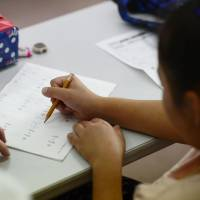 An elementary school student studies mathematics in Fukuoka Prefecture in May, as part of a study support program for children in poverty. | ISTOCK