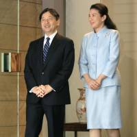 Crown Prince Naruhito leaves his residence in Tokyo for a weeklong visit to Denmark as Crown Princess Masako sees him off. | POOL /VIA KYODO