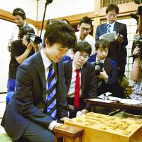 Sota Fujii, at 14 the youngest professional shogi player, looks relieved Wednesday at Kansai Shogi Hall in Osaka after winning his 28th official match in a row, equaling the record set in 1987 by Hiroshi Kamiya. | KYODO