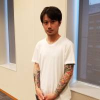 Taiki Masuda says that setting up a licensing system that recognizes what tattoo artists create will help put an end to the industry's shady standing in Japan. | TOMOHIRO OSAKI