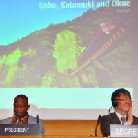 U.N. Educational, Scientific and Cultural Organization members give a round of applause Wednesday at the agency's headquarters in Paris after it was decided to add the Tone River basin north of Tokyo and a mountain range in the country's southwest to the list of biosphere reserves. | KYODO