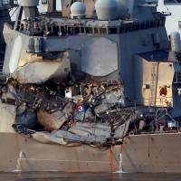 The USS Fitzgerald, damaged in a collision with a merchant vessel, is towed into the U.S. naval base in Yokosuka, Kanagawa Prefecture, on June 17.   REUTERS
