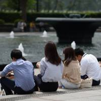 Nearly half of newly employed workers said they would go home when their own work was finished, even if their superiors were working overtime, according to a survey conducted jointly by Japan Productivity Center and Junior Executive Council of Japan. | BLOOMBERG