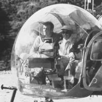 Sean Connery (left) sits in a helicopter on the set of 'You Only Live Twice' in Kagoshima Prefecture in 1966. | AP