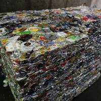 Compressed can bales sit at the Minato Resource Recycle Center in Tokyo. | TIM HORNYAK