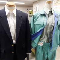 Clothes made from recycled PET fibers are displayed at the Minato Resource Recycle Center in Tokyo. | TIM HORNYAK