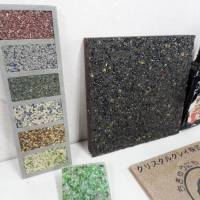 Tiles made from recycled glass sit on display at the Minato Resource Recycle Center in Tokyo. | TIM HORNYAK