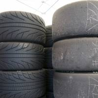 Tired out: Burnt out slick tires (right) stand next to unused treaded tires in a paddock at Autopolis in Oita Prefecture. | OSCAR BOYD