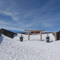 Snowed in: The torii gate of the shrine atop Mount Fuji welcomes its guests. | OSCAR BOYD